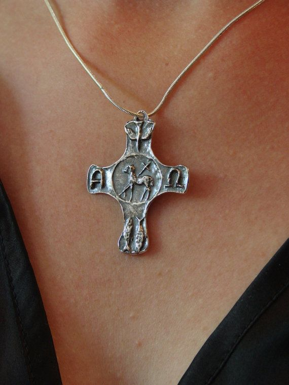 NEW this is very unique solid sterling silver .  Nearing the center of the cross, humanity enters eternity where one partakes in the life of Christ, the Paschal Lamb, the Alpha and Omega of our lives and of all creation. We are guided by the spirit and nurtured by Holy Communion. From our beginning to our end, this is the truth to which we consecrate our lives.  Revelation 5:5-6 Then one of the elders said to me, Do not weep! See, the Lion of the tribe of Judah, the Root of David, has…
