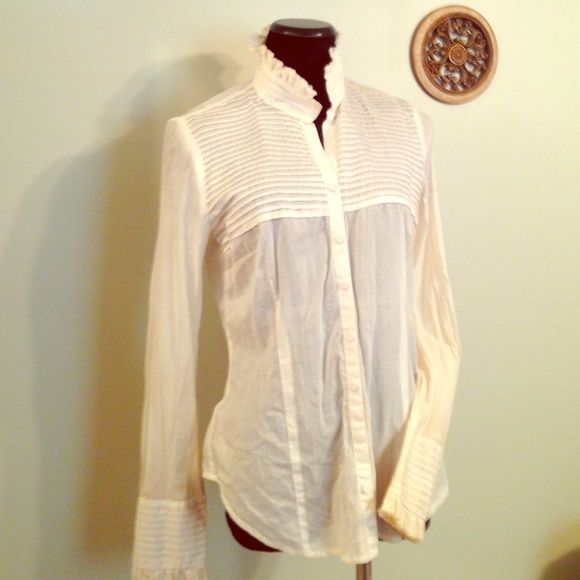 EUC ANN TAYLOR LOFT size 10 ruffle button-up top Absolutely gorgeous Ann Taylor loft career shirt, The shirt is absolutely beautiful and perfect with a Cami. I only say Kami because it is a very thin material though you should be able to get away with the color wearing nude underneath it perfectly. Gorgeous ruffled sleeves ruffled top ruffled collar button up the neck does not button all the way to the collar . Off white in color or antique white. On it is a couple of make up stains inside…