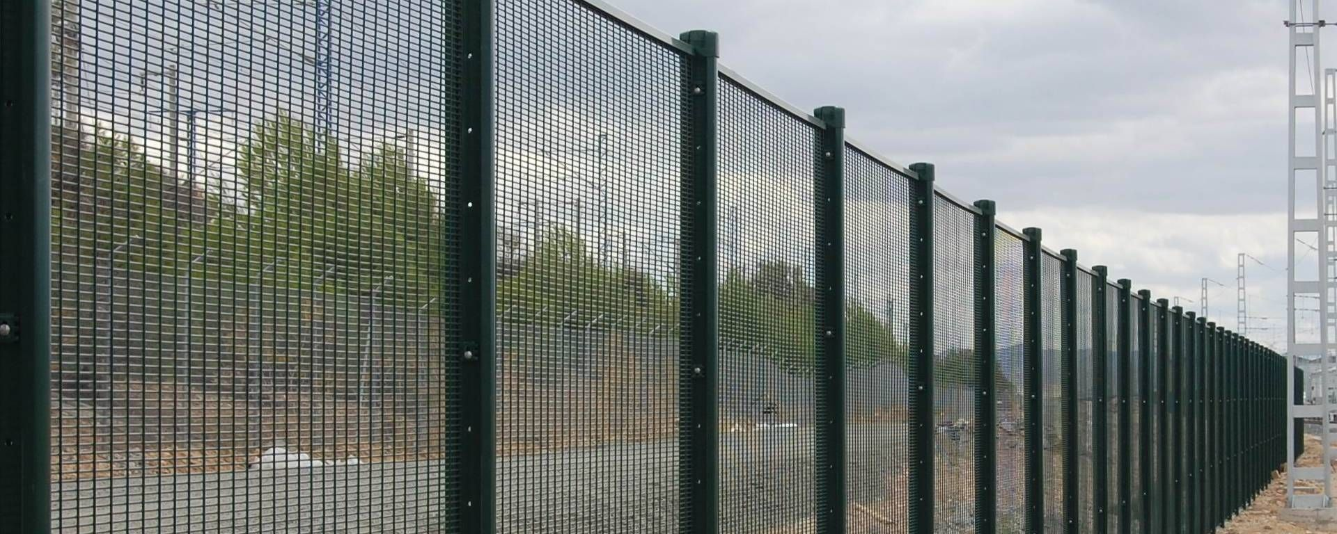 A line of 358 mesh fences are installed on the roadside.   358 mesh ...