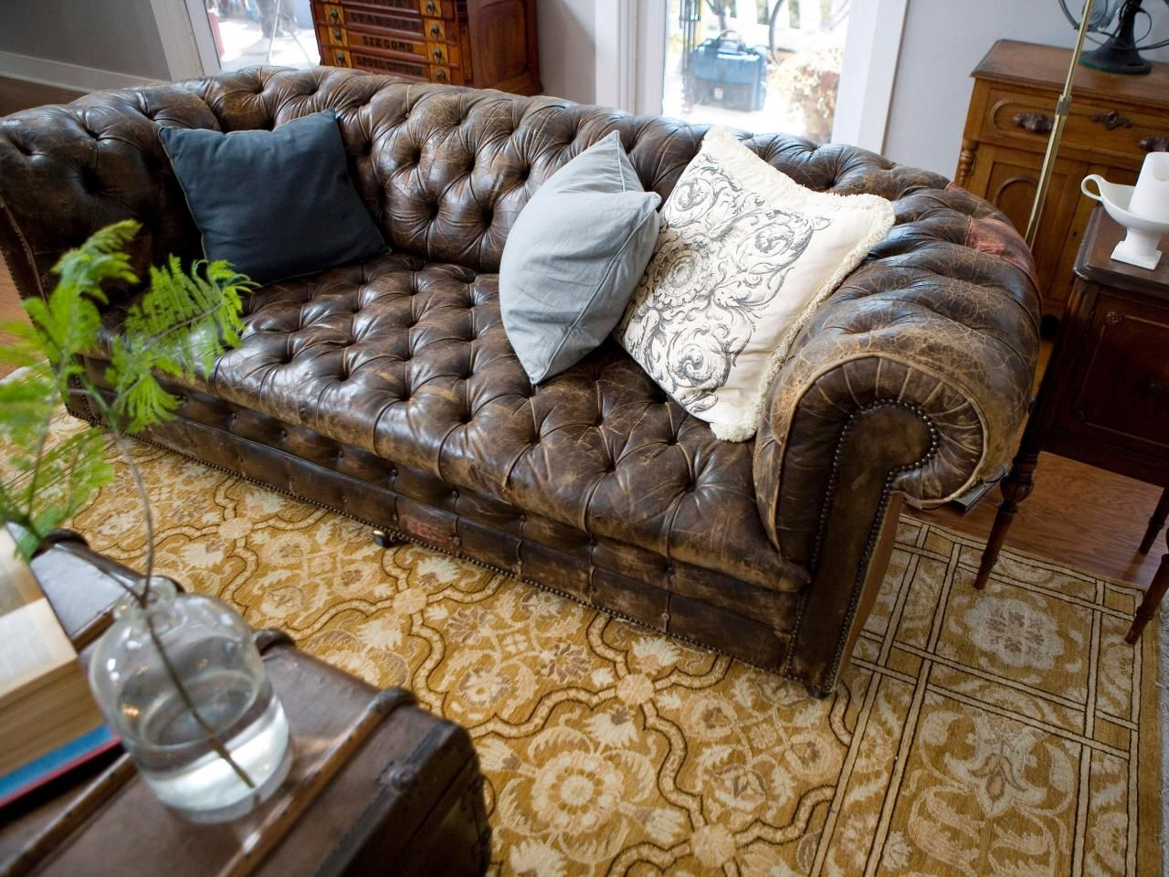 Comfy Leather Couches this traditional living room pairs a neutral persian rug with