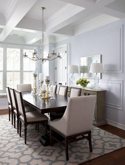 Dining Room Beige Chairs Dark Wood Table Crystal Chandelier Crystal Lamps  Trellis Rug Candleholders