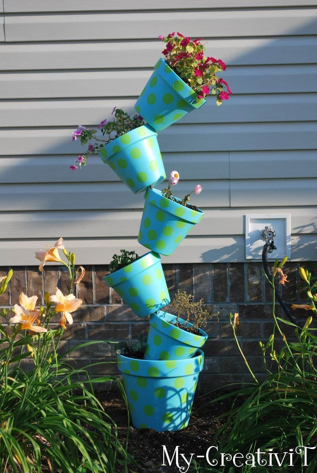 21 Flower Towers You Can Make In A Weekend Flower Tower Recycled Garden Art Planter Pots