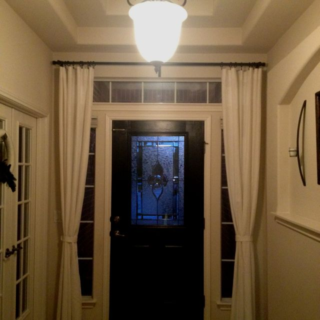 Hang Curtains Around The Front Door To Close At Night For Added