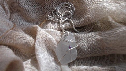 A white piece of Cornish Sea Glass by Anne Newton