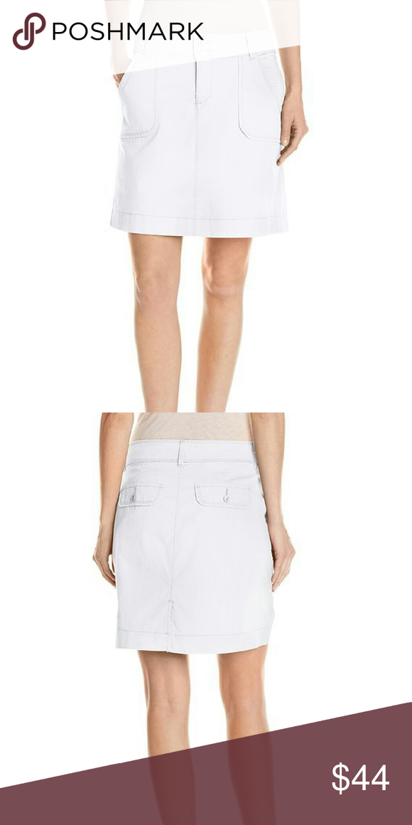 """Natural Fit Georgia Skort 98% Cotton, 2% Spandex; Marina Santorini Plaid: 97% Cotton, 3% Spandex. Machine Wash. Instantly slims you! Look and feel slimmer with this tummy panel. Utility detailing. Stretch canvas.  Rise: 10.375"""", Back Length: 17"""", Short Inseam: 5"""". Product measurements were taken using size 10. Please note that measurements may vary by size. Shorts Skorts"""