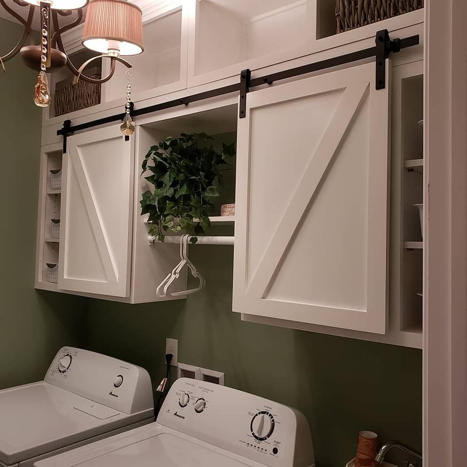 Custom Designed Sliding Barn Door Laundry Room Cabinets With