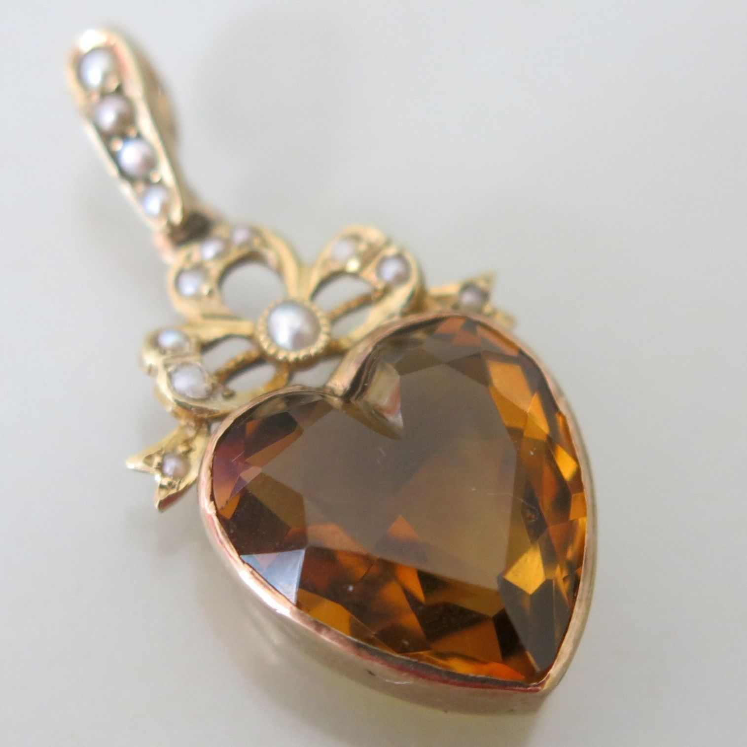 A vintage gold and natural citrine heart pendant from the edwardian a vintage gold and natural citrine heart pendant from the edwardian era mozeypictures Image collections