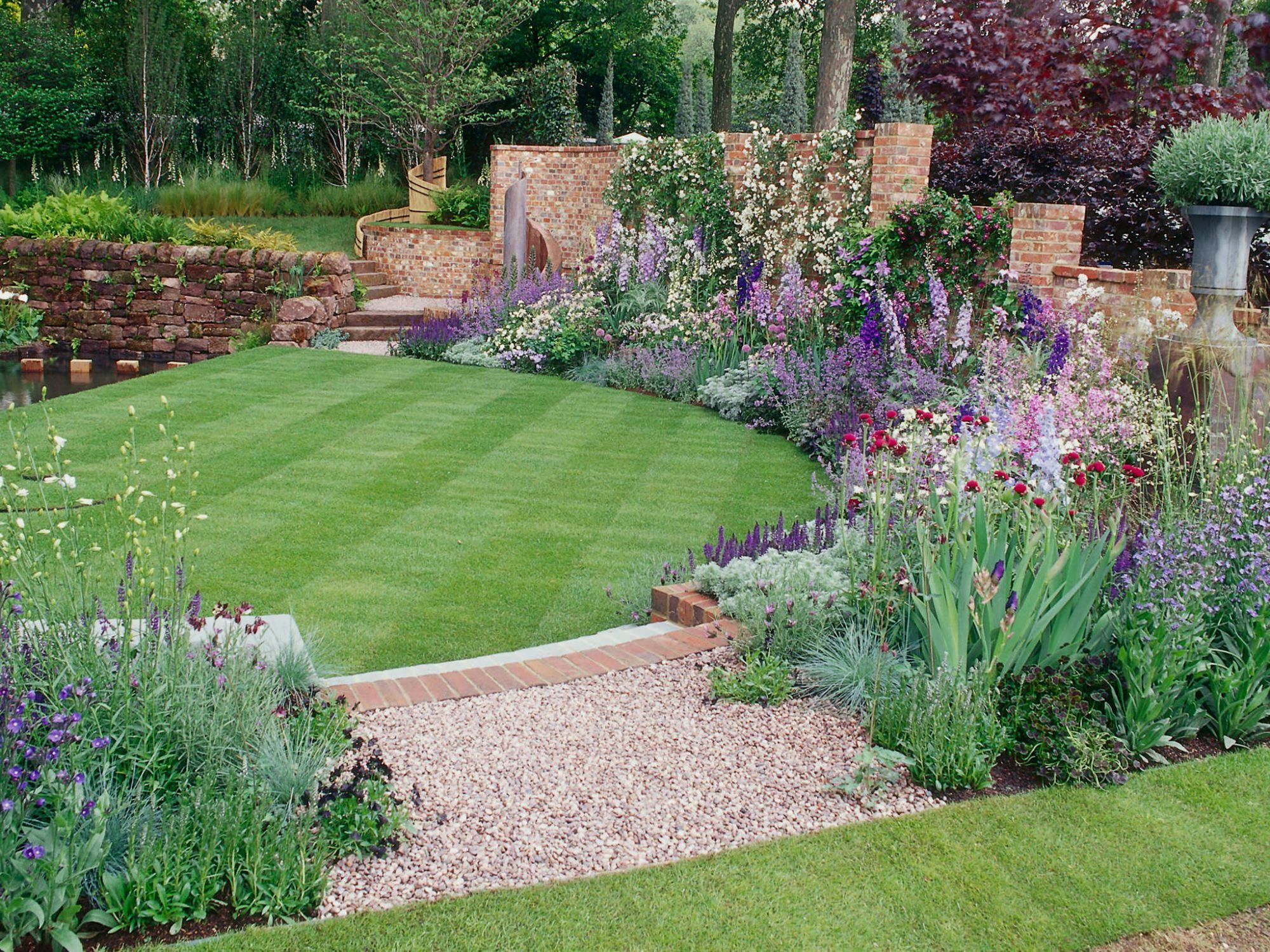 need backyard ideas try these fixes for a sloped shady or boring