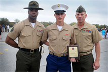 Private First Class Garrett Glassman, honor graduate of platoon 3028, stands with Lt. Col. David Glassman, his father, and Sgt. Leroy McGee, his Senior Drill Instructor, after graduation aboard Parris Island, S.C., April 12, 2013. Glassman is a native of and recruited from Gulf Breeze, Fla., by Staff Sgt. Jessica Castleberry, from Recruiting Sub-Station Pensacola, Recruiting Station Montgomery. After graduation, Glassman will be able to enjoy some much deserved leave before heading to Camp…