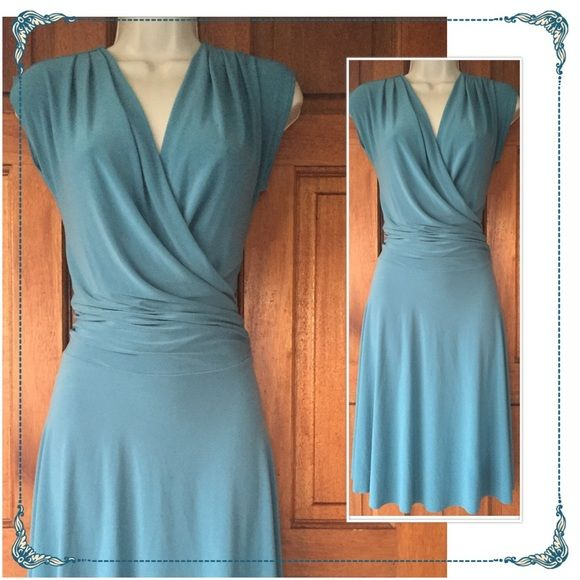 Faux wrap dress blue sz M Slip on style, faux wrap, the last pict shows the only defect on the dress very small, price reflects that. Sporano Dresses