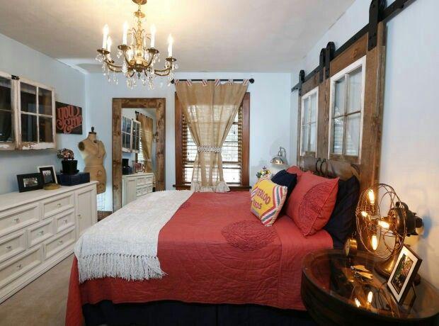 Elegant vintage & repurposed master bedroom. Love the barn door headboard & chandelier.  www.dapperdesignsdecor.com