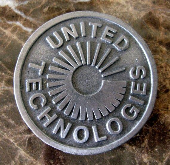 "Vintage ""United Technologies"" Perfect Circle Metal Belt Buckle. $14.00, via Etsy."