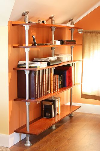 a pole mounted bookshelf built with kee klamp pipe and wooden shelves this diy