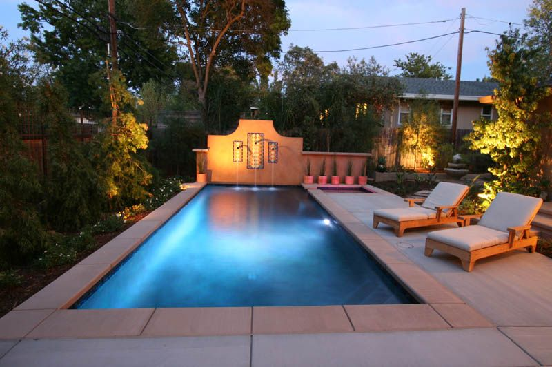 Photo of spanish style design with stucco wall and scupper waterfall fair oaks ca swimming for What is swimming pool in spanish
