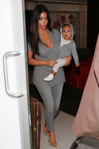 Kim and North Wore Matching Travel Outfits Kim and