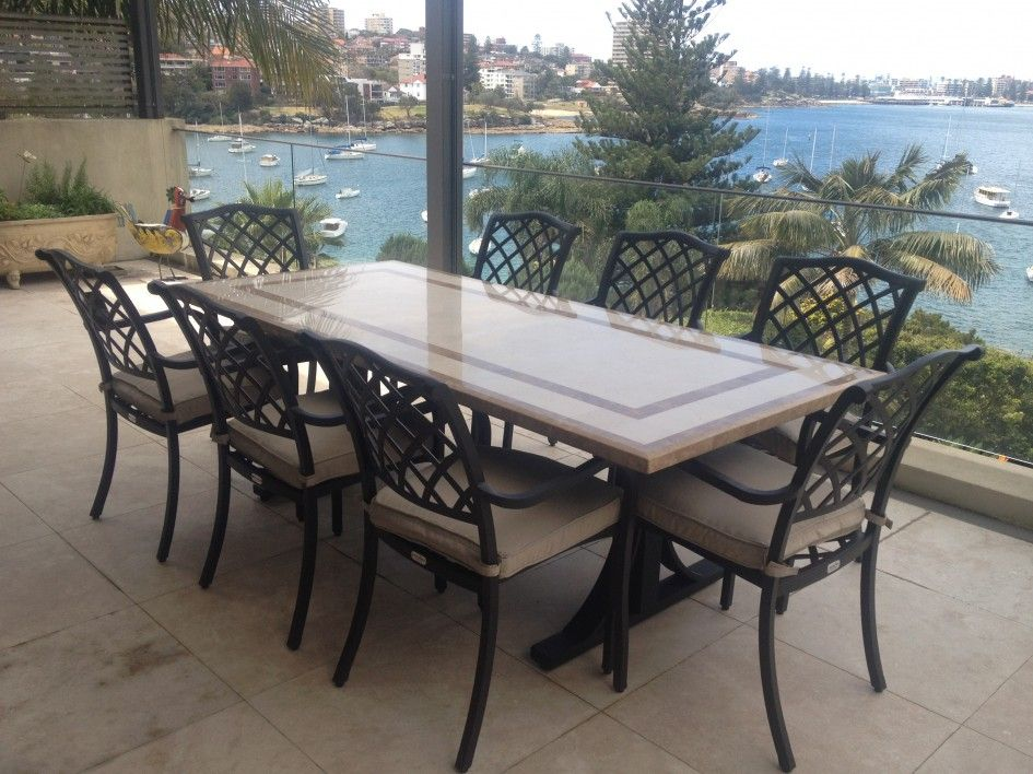 Stylish outdoor stone patio tables with faux marble top on for Best outdoor dining