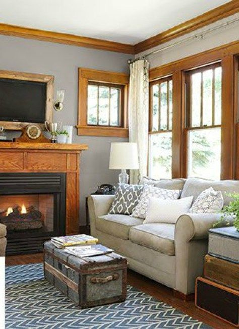 Yellow and gray living room features a gray corner reading chair ...