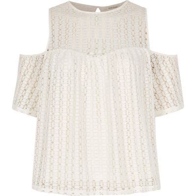 I'm shopping Cream cold shoulder lace top in the River Island iPhone app.