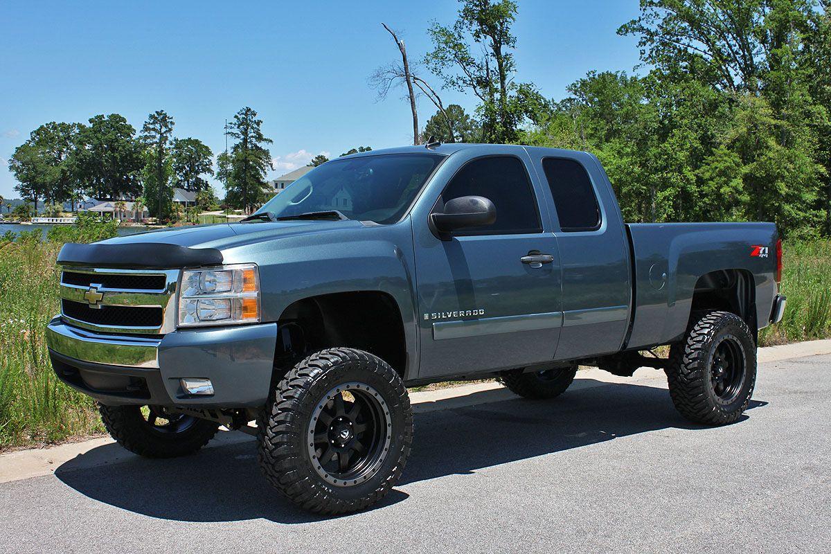Light blue color lifted chevrolet silverado truck