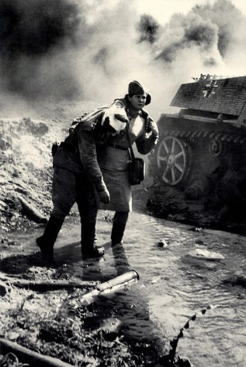 A Soviet nurse in action on the battlefield, 1943.