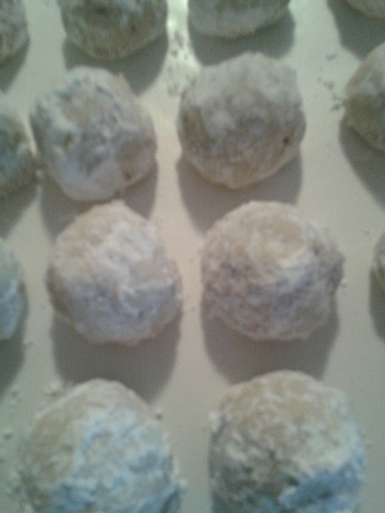 Snowball Cookies   2 c flour, 1/2 c powdered sugar, 1/8 tsp salt, 1 c butter, 1 tsp vanilla, 1 c chopped pecans, Hershey Kiss, powder sugar,   In large bowl, combine 1st three ingred. Using pastry blender or fork, cut in butter until mixture resembles coarse crumbs.  Add vanilla and nuts; mix to form smooth dough.  Wrap dough around Kiss.  Place on ungreased cookie sheet.  Bake 5-7 mins. or until set and light golden brown.  Cool 1 minute; remove from cookie sheet.  Roll in powder sugar…