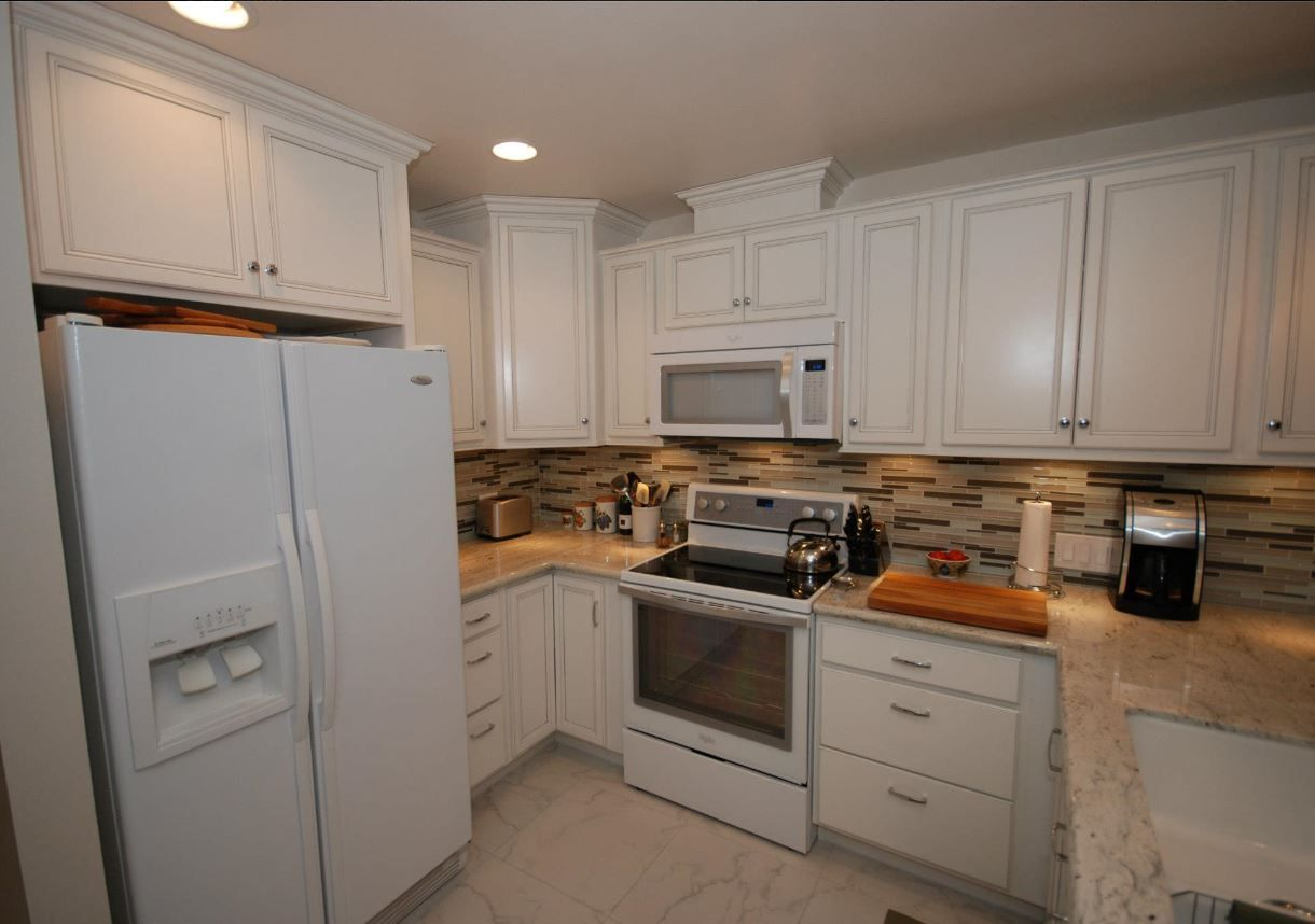 Cardell White With Silver Glaze Cabinets With River White