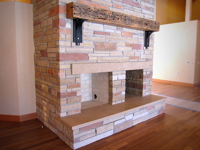 This Concrete Hearth Has Been Ground To Expose Some Of The