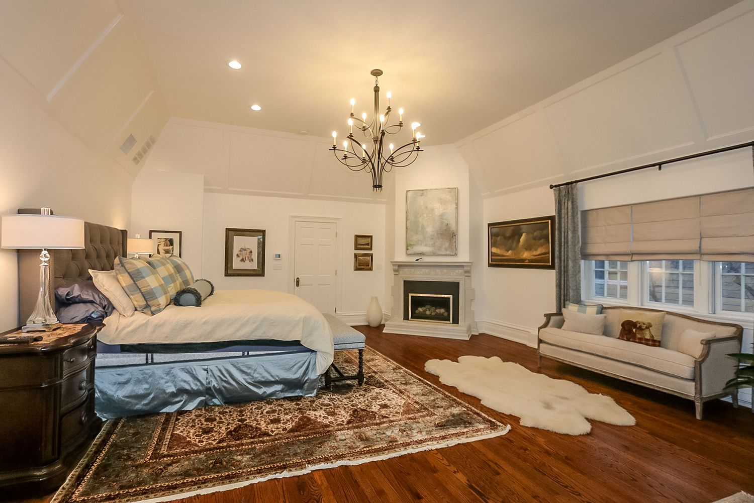 Master bedroom huge  Vaulted master suite with an elegant fireplace spa bath and a huge