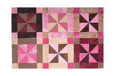 Give this easy framed pinwheel quilt block pattern a try to make 12-inch pinwheel quilt block and a smaller 6-inch version.