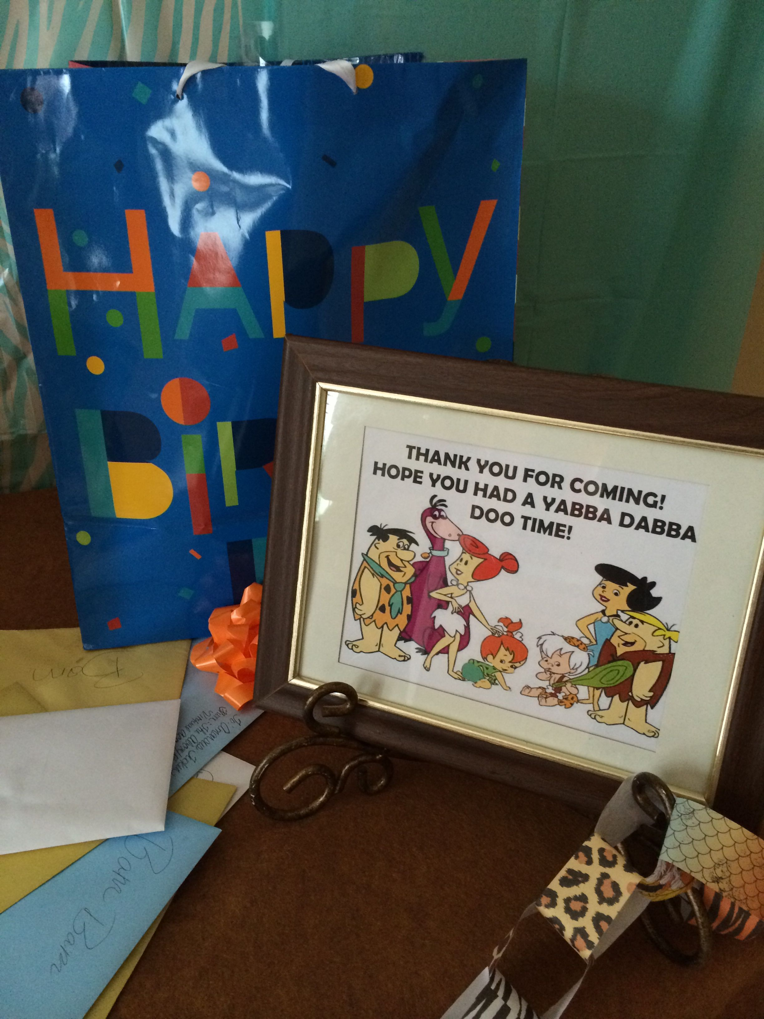 Gift table for flintstone party with images birthday