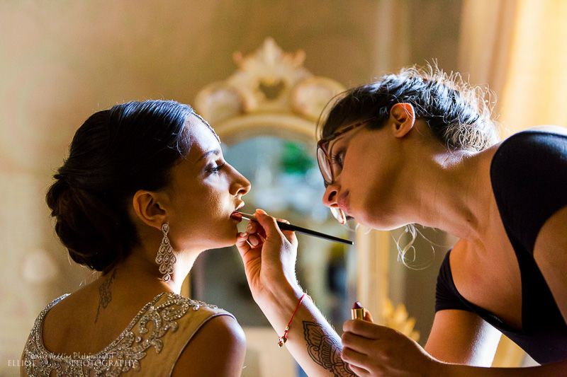 Bride With The Makeup Artist Getting Ready For Her Wedding In The