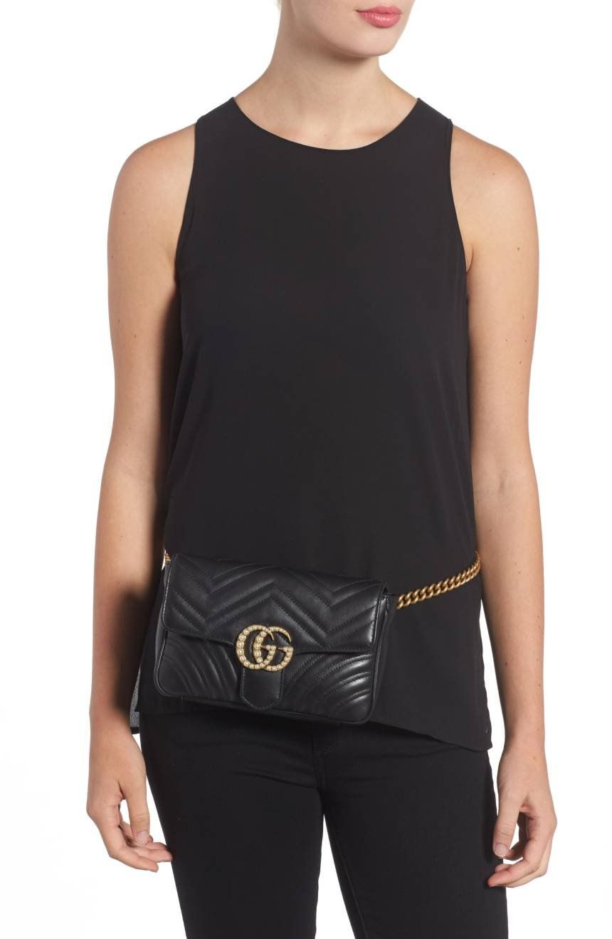 85c1d6fa1c09f2 ... in the Gucci archives and embellished with imitation pearl highlight  the matelassé-quilted leather belt bag finished with a gleaming, chain-link  strap.