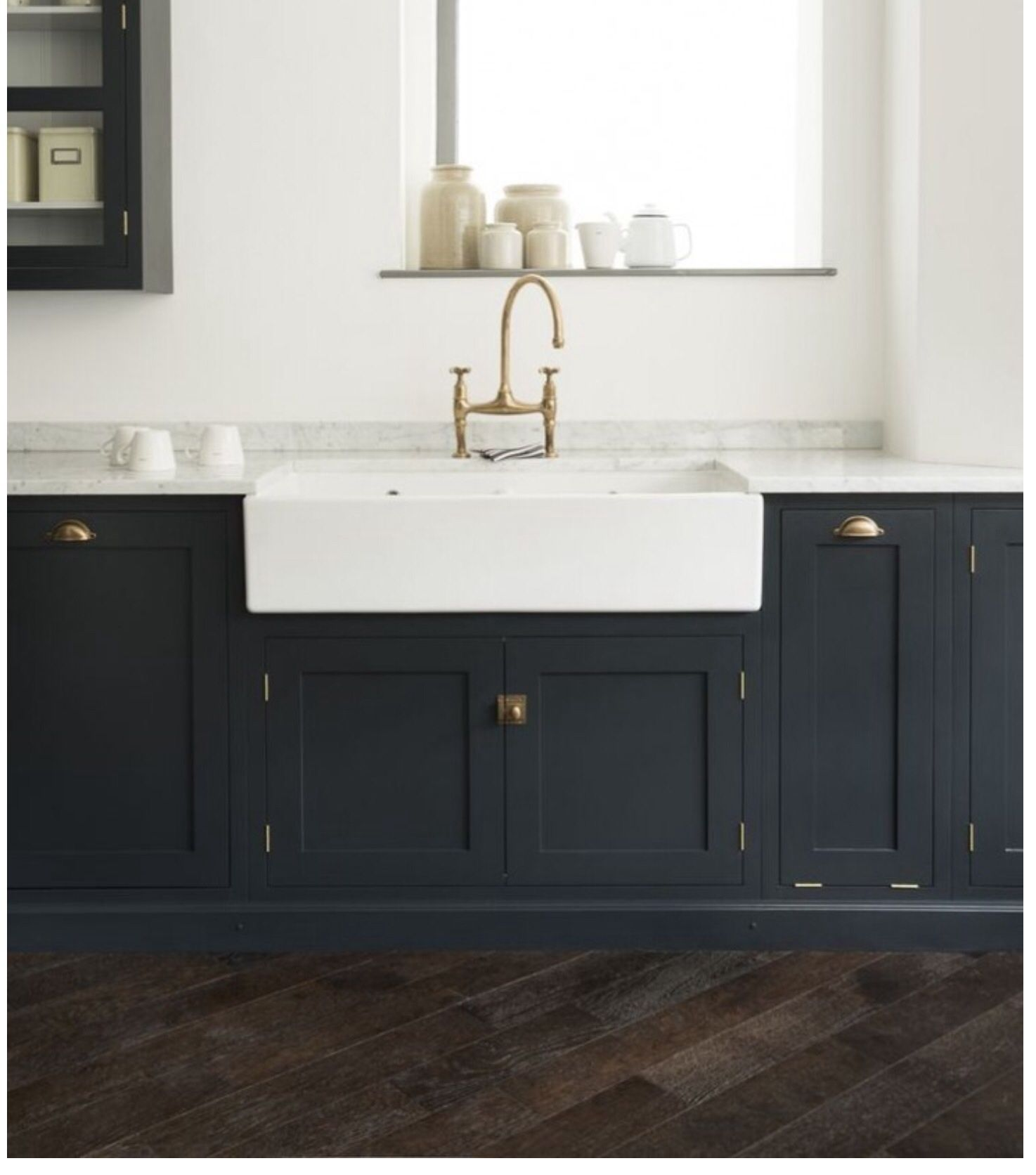 Hello dark navy cabinets and lots of brass The key to