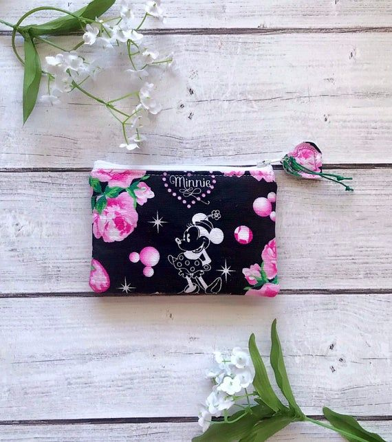 Minnie Mouse zipper pouch- Black with pink flowers- Available in multiple sizes- Great for cash, cards, makeup & supplies- Eco friendly