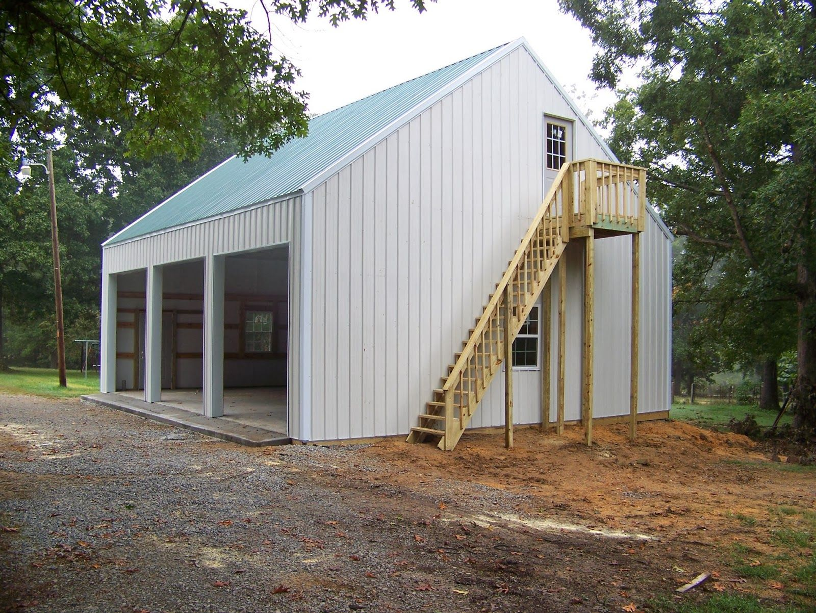 Steel building with loft this is a 3 car 30x36 garage for Pole barns with apartments