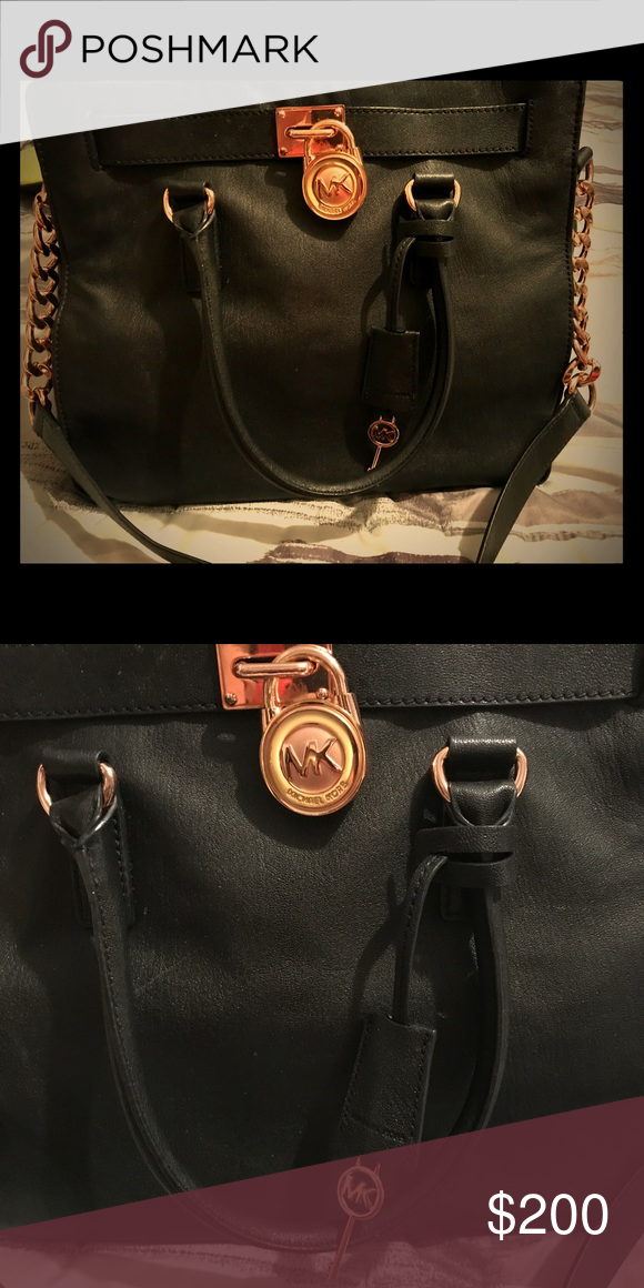 27097853cf3f7a Micheal Kors Hamilton purse Black leather Large Hamilton in good condition. Rose  gold lock and