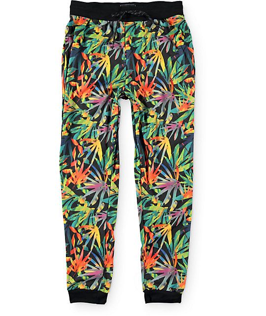 Add stand out style to any outfit with an all over sublimated tropical floral print in vibrant colors and a soft fleece lining for great comfort.