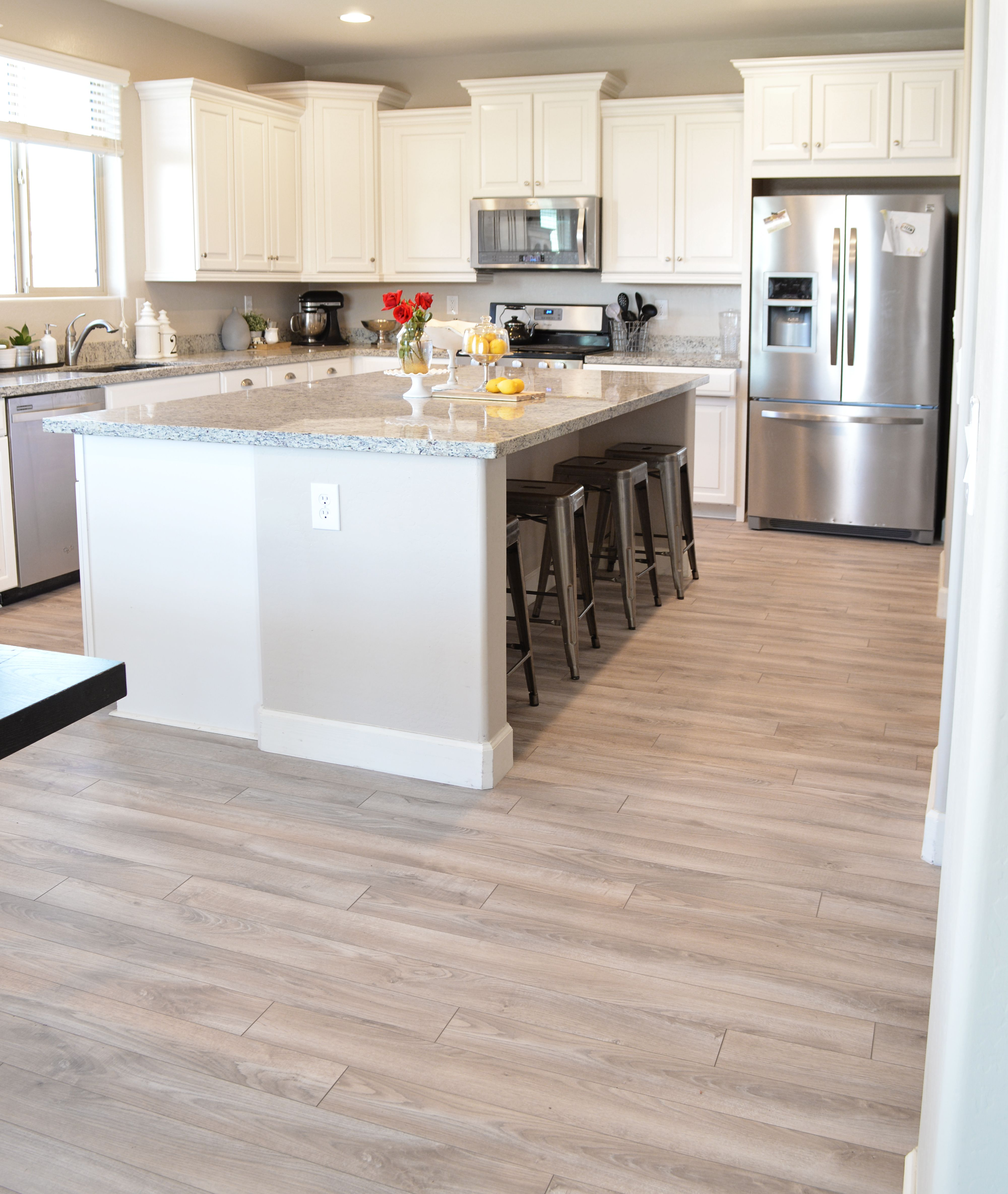 9 kitchen flooring ideas stainless appliances cabinet for Laminate kitchen flooring pros and cons