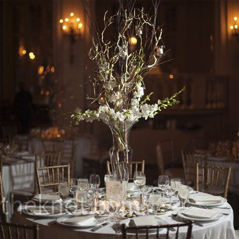 Tall orchid centerpieces manzanita branches and orchids for Tall wedding centerpieces with branches
