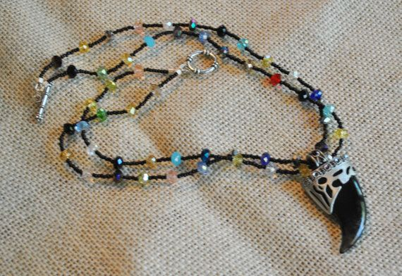 Double Strand Mulit-Colored Small Bicone Crystal Bead, Black Seed Beads with a Large Black Acrylic Bear Claw Pendent