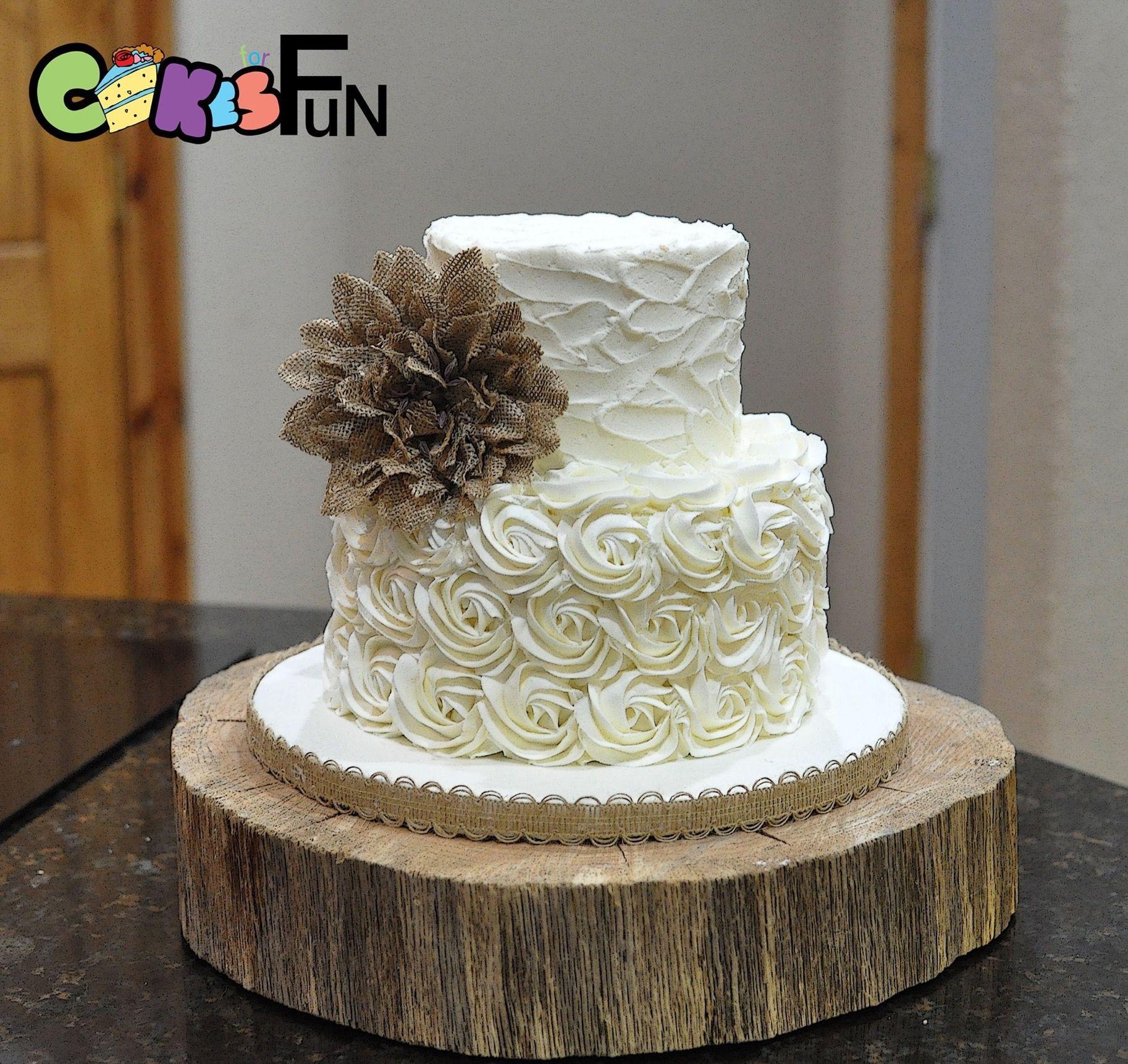 rustic buttercream wedding cake . 2 tiers - with burlap flower