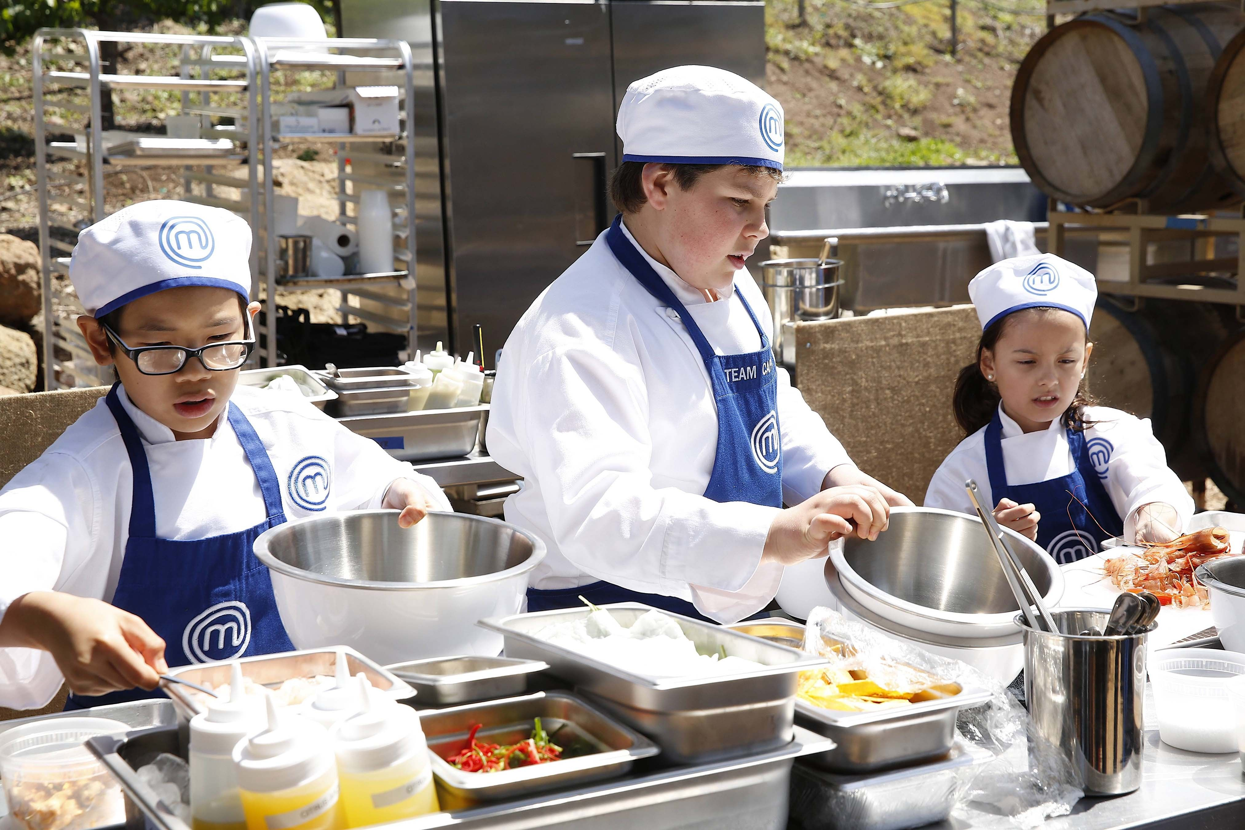 Contestants sam sean and oona prepare their meals in a