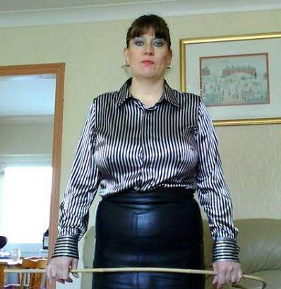 Brunette bit leather skirt spanked