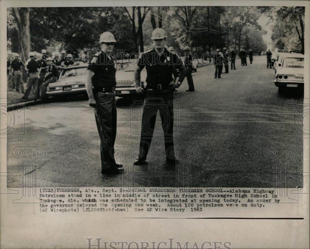 September 2, 1963: Gov. George Wallace postpones the opening of Tuskegee High School to prevent its integration. State troopers enforced the order, preventing the school from becoming Alabama's first racially integrated public grade school. Wallace took similar action in Birmingham, Huntsville, and Mobile, but four Huntsville schools were integrated on September 9th.