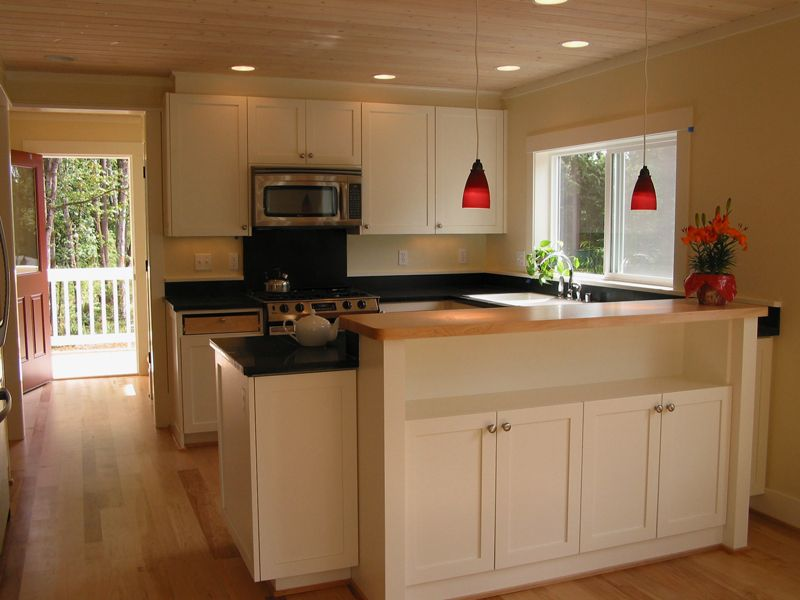 Edgemoor Cottage | Ross Chapin Architects. View of kitchen and back ...