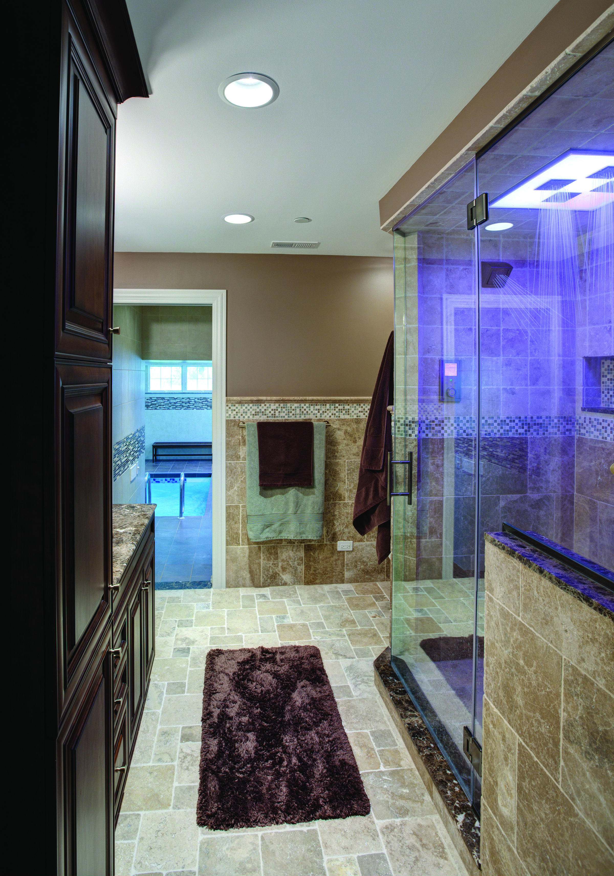 Bathroom   A Rain Head Shower And Water Tile Overhead, Body Sprays On Both  Sides, And Waterproof Sound System Create The Ultimate Shower Experience.