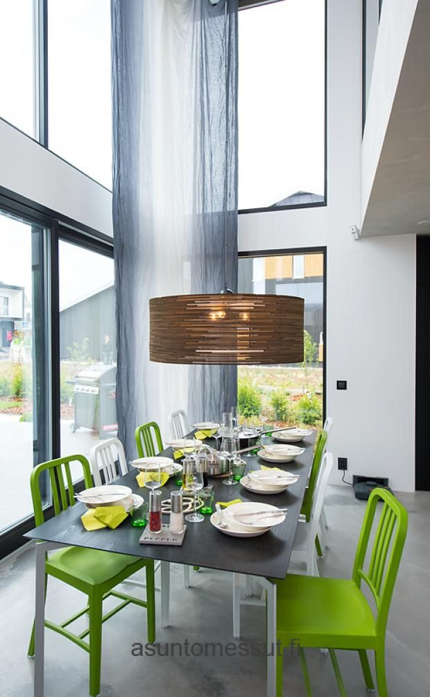 Loving the spacious dining room, big windows, light, and green.