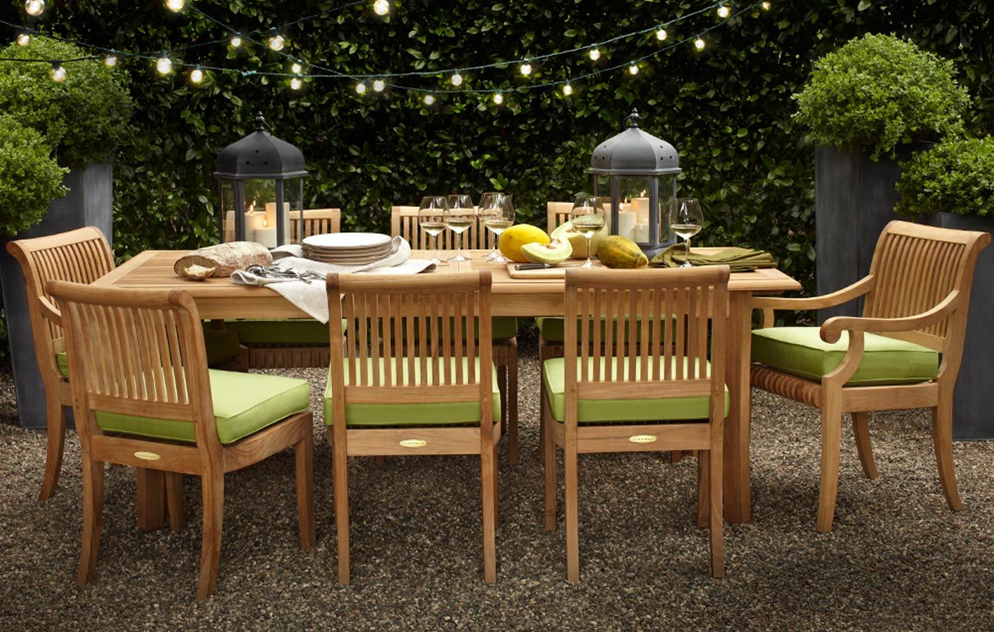Full page image showing Smith & Hawken Avignon Teak table and chairs set up  outside. - Full Page Image Showing Smith & Hawken Avignon Teak Table And Chairs