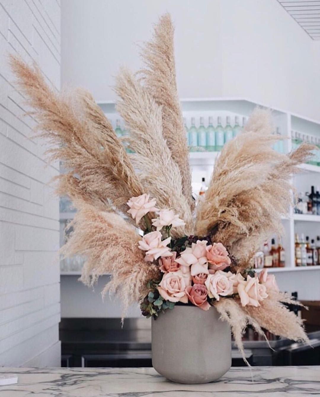 Dramatic centerpiece with pampas grass, blush and white ...