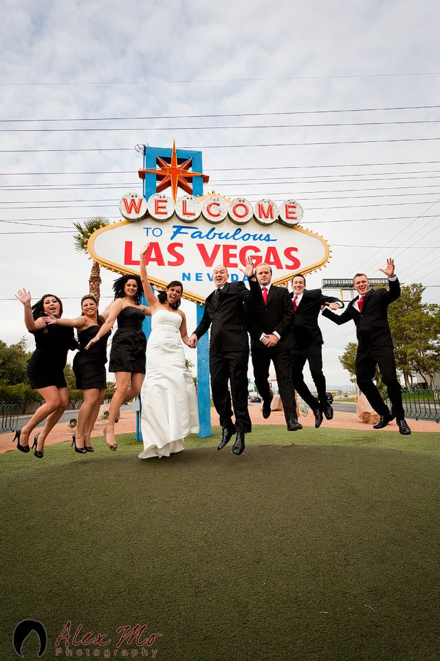 a happy wedding party at the Las Vegas sign